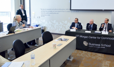 """During the JPMCC's Research Council meeting on September 30, 2016, Professor Emeritus Margaret Slade (with microphone) addressed the morning session's panelists. Pictured here, the panelists at the """"Emerging Risks and Challenges in Commodity Supply Chains"""" morning panel were (from left-to-right) Professor Nikos Nomikos, Cass Business School, City University London (UK) and member of the JPMCC Research Council; Mr. John Schmitter, KEP LLC; and Mr. Steffen Hammer, Robert Bosch GmbH (Germany). Mr. Hammer's colleague at Bosch (Germany), Sven Streitmayer, recently joined the JPMCC's Research Council."""