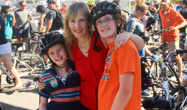 Alum Anne Bailey and boys on bike ride